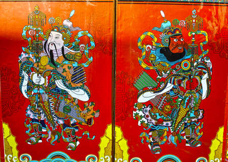 Chinese Door God  In order to pray for a good fortune,long life,health and peace for the family, traditional Chinese family like to post the picture of Door God to the door of their home  It is said that door God is a symbol of Justice and force  Stock Photo