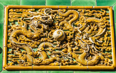 confucian: Two dragons are curvetting with a pearl, photoed in Confucian Temple, Beijing