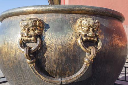 Bronze handle of the water vat in Forbidden City Stock Photo