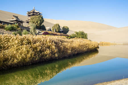 crescent lake: Crescent Spring and Mingyue Pavilion under the sunshine, Dunhuang of China