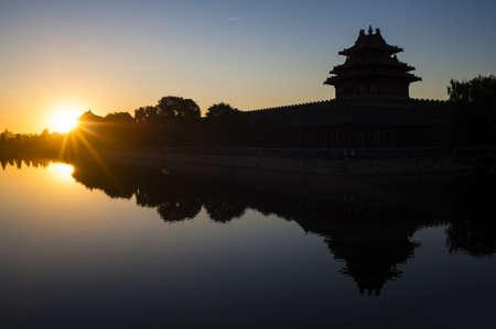 forbidden city: Watchtower of Forbidden City at sunrise  Stock Photo