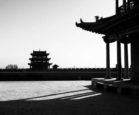 jiayuguan: Jiayuguan tower under the shadows  B W  Stock Photo