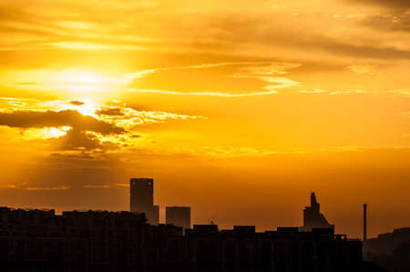 gloden: Sunrise on the gloden color sky in the city Stock Photo