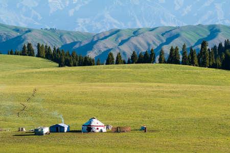 Some Kazak yurts at the grassland in the morning