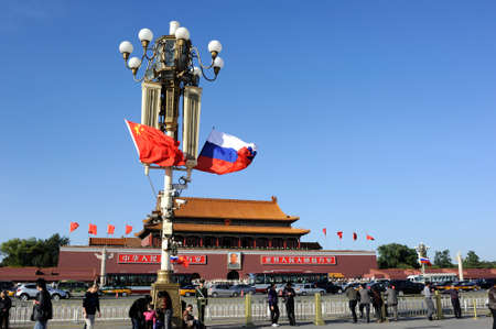 communistic: Tiananmen square, flying national flag of Russia and China Editorial