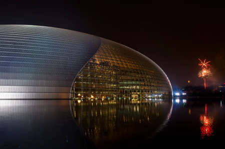 China national theater and the fireworks in the eve of Chinese New Year