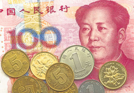 Chinese renminbi 100 bank note and coins Stock Photo