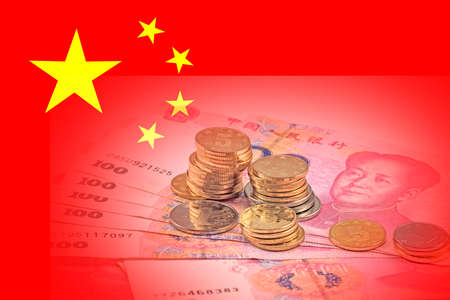 Chinese money on the background of Chinese national flag