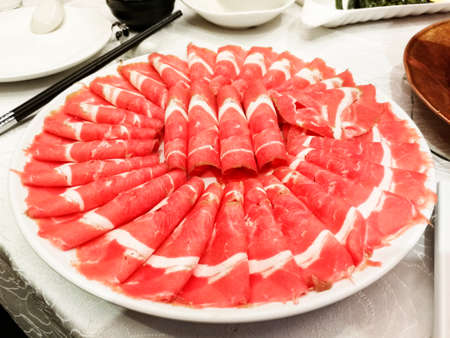 primarily: Sliced mutton for hot pot,  a very popular Chinese dish,especially in Beijing,and is primarily eaten in winter