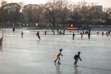 BEIJING, CHINA-January 14, 2016: Pepole skating at a park