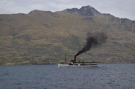 A steam driven vessel sail on Lake Wakatipu, New Zealand Stock Photo