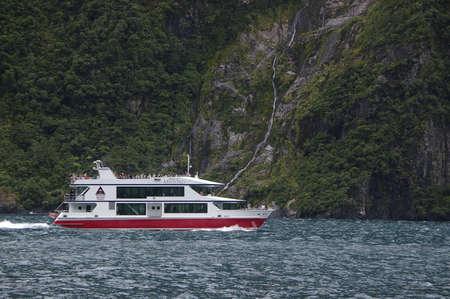 A tourist boat in Milford Sound, New zealand