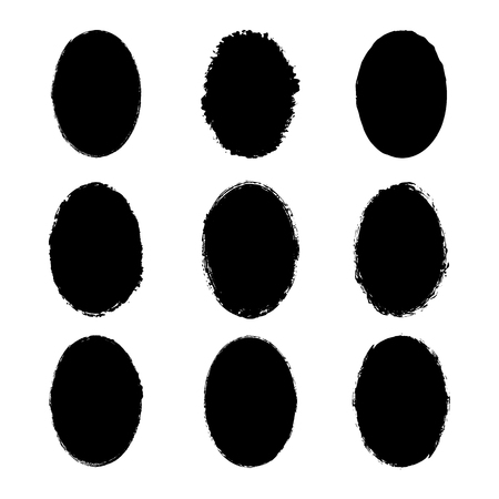 A vector collection of oval grunge textured paintbrushes painted with ink brushes with uneven rough edges. Set of dirty oval silhouettes of black color isolated on white background