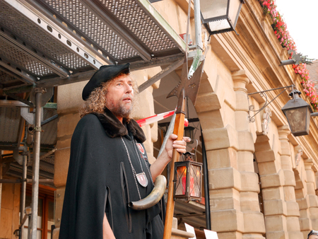 ROTHENBURG O.D.T., GERMANY - July 20, 2016: The Night Watchman at Marktplatz entertaining and giving informations to tourists who joined his night tour.