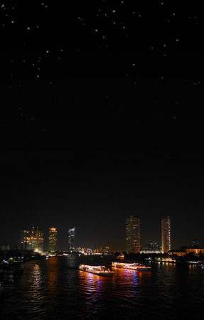 Bangkok night riverside with starry sky