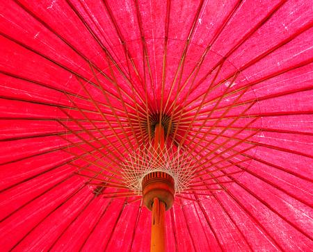 paper umbrella: Under red Thai traditional paper umbrella