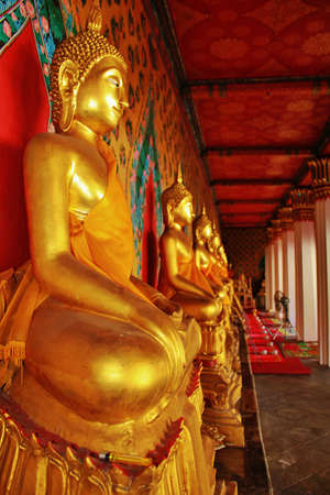 subduing: Wat Arun or Wat Chaeng In the gallery of  the main chapel, there are 120 stuccoed Buddha image in the attitude of  subduing Mara ,the evil spirit. Thailand
