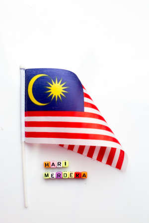 Malaysian flag with dice test wrote hari merdeka Stock Photo