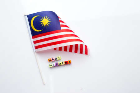 Malaysian flag with dice test wrote hari merdeka Stock Photo