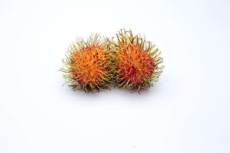 tropical friut called rambutan on white background