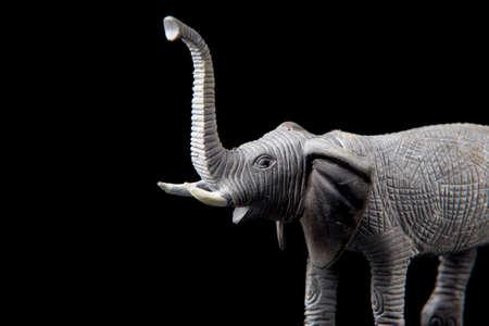 elephant toy figure on dark isolated background, selective focus, shallow depth 免版税图像