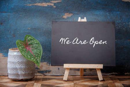 beginnings: blackboard written we are open Stock Photo