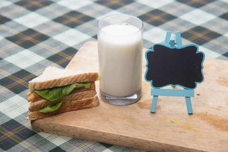sandwich and glass of fresh milk, blackboard