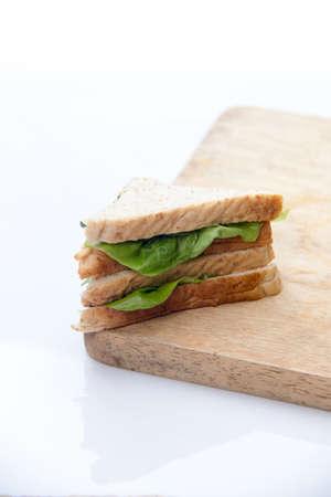 home made sandwich on cutting board