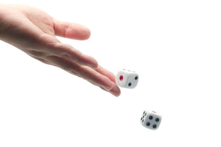 hand throwing dice on white isolated background, selective focus