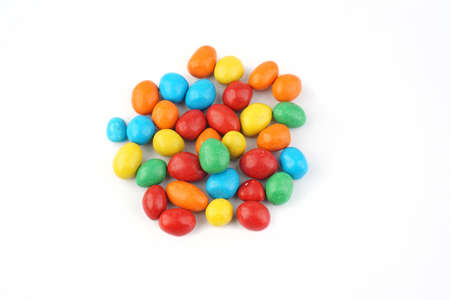 colorful chocolate coated peanut on white isolated background