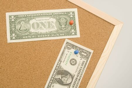 One dollar bills on a cork board with copy space. Money concept Stock Photo - 5822044