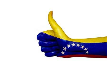 Venezuela flag painted on hand showing thumbs up