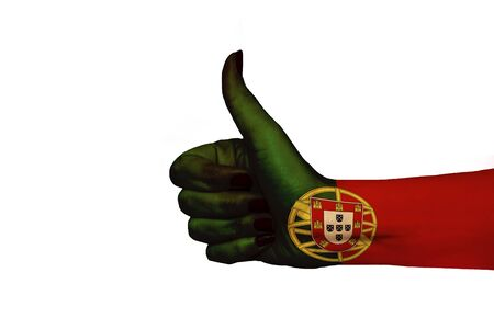 Portugal flag painted on hand showing thumbs up