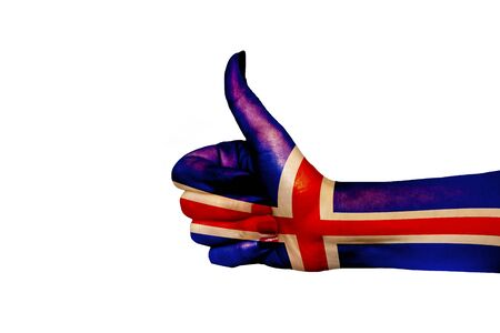 Iceland flag painted on hand showing thumbs up