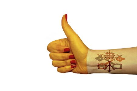 Vatican flag painted on hand showing thumbs up