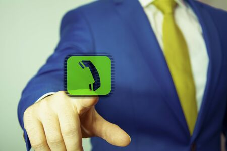 Businessman pressing phone button, visual screen. Communication concept