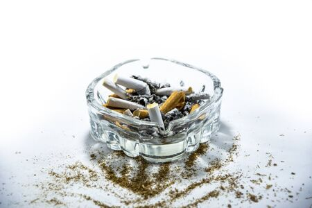 Dirty ashtray with cigarette