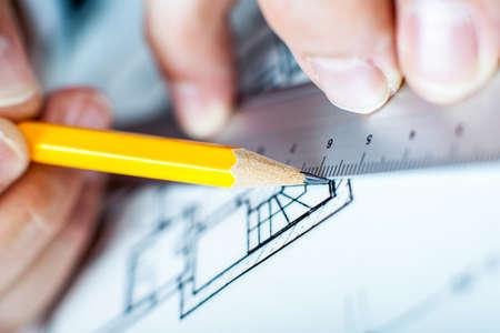 architect: Architect draws Stock Photo