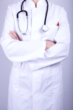 surgery expenses: doctor crossed arms