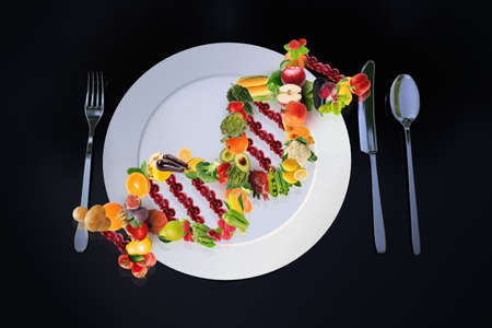 Genetic science interested in nutrition genetics is called Nutrigenetics. DNA strand made of fresh and healthy fruits and vegetables concept and idea.