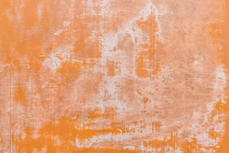 Peeling orange paint abstract texture from old worn light wood background. Standard-Bild