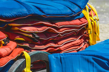 Life jackets, protection and safety of life on the water against the background of the sea. Stock Photo