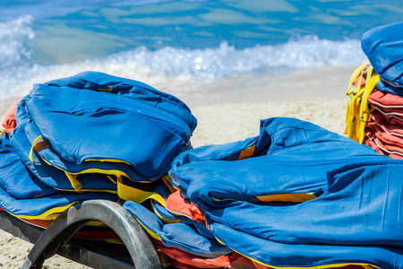 Life jackets, protection and safety of life on the water against the background of the sea.