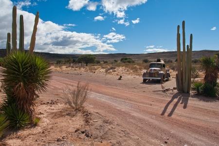 Rusty car in desert Stock Photo - 9377370