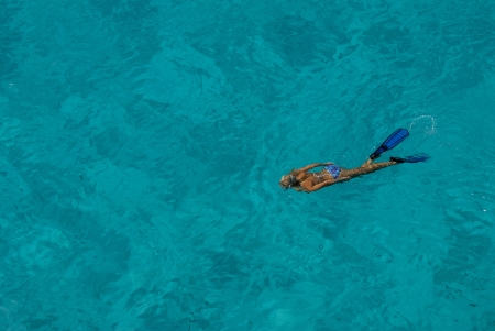 freediver: A female freediver in the clear blue water of the Mozambique Channel, Bassas Da india