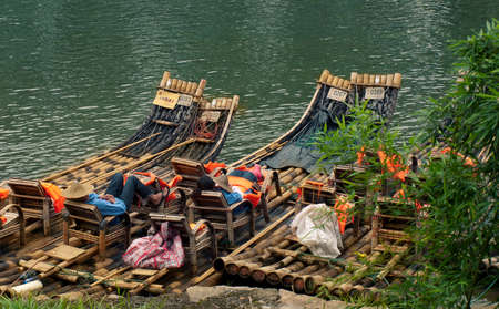lifevest: bamboo raft drivers resting during lunch time in Wuyishan, China