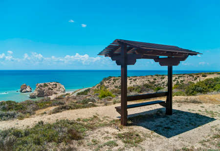 tou: bench with roof facing petra tou romiou in Cyprus