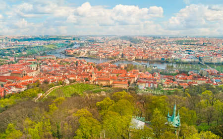 View of Prague historical center and green park from Petrin tower observation deck on sunny spring day, Prague, the Czech Republic