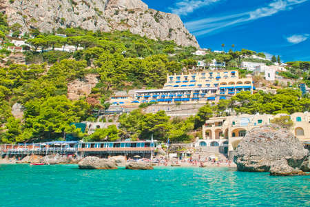 view of Marina Piccola beach from sea with mountain, hotels and restaurants behind it on sunny summer day, Capri, Italy Stockfoto