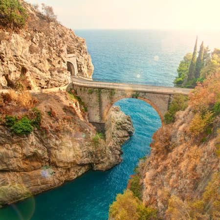 beautiful bridge over small Fiordo di Furore on Amalfi coast of Italy on sunny summer day